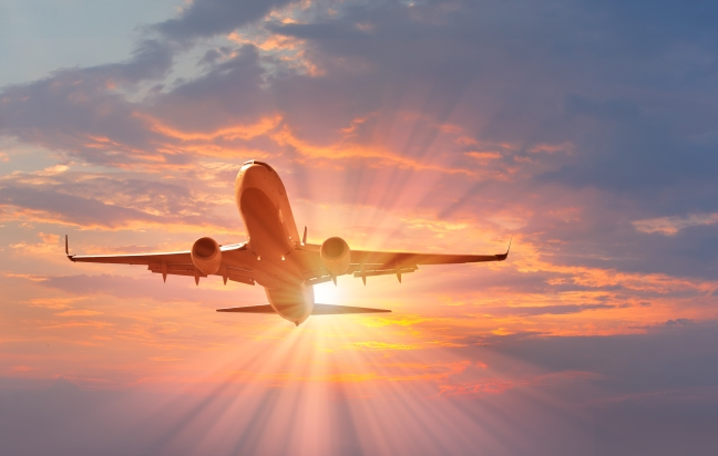 plane-in-sunset-shutterstock